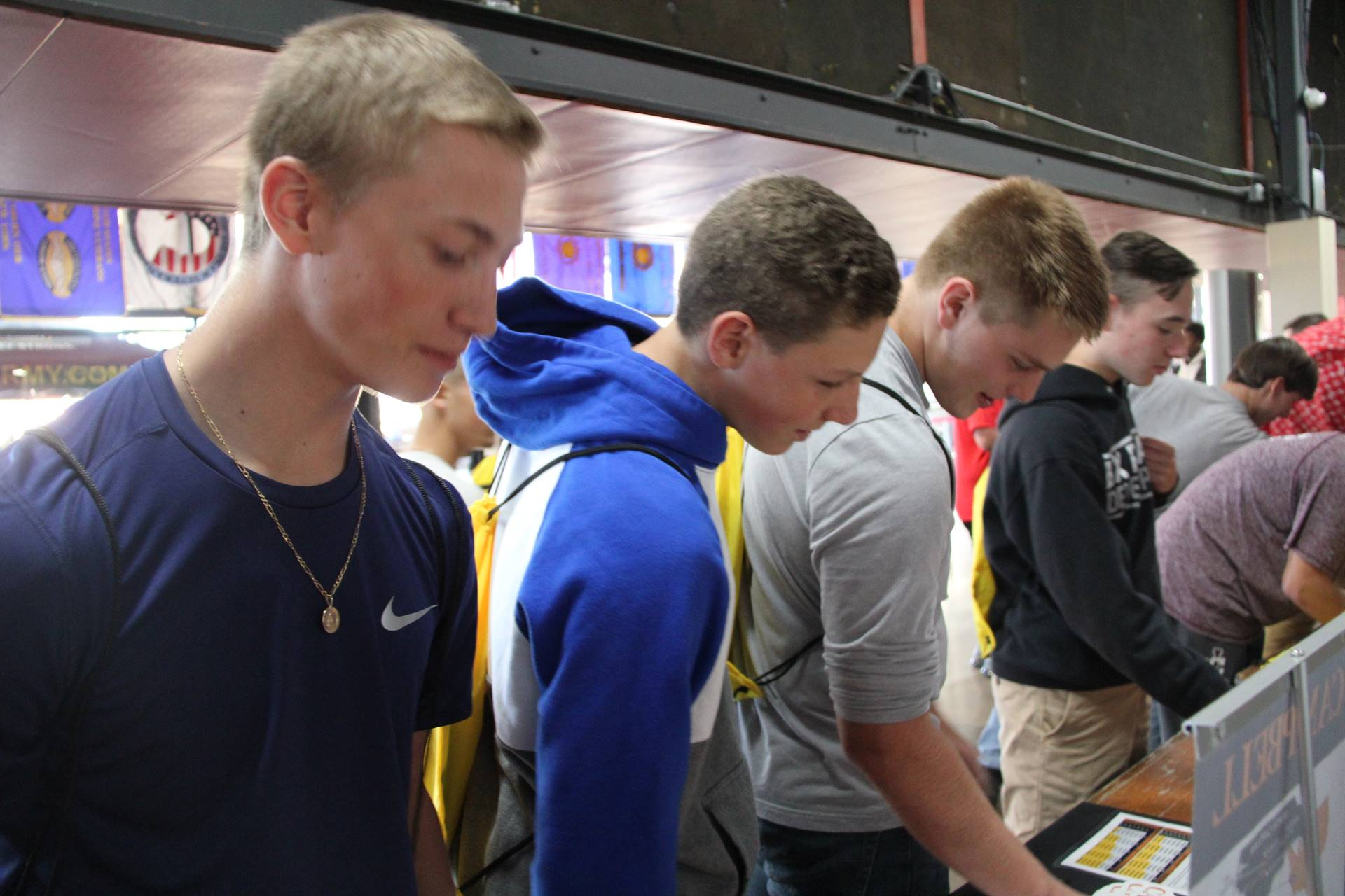 students browse pamphlets at college day