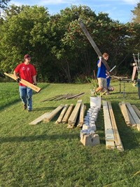 students move strips of wood for ramp it up project