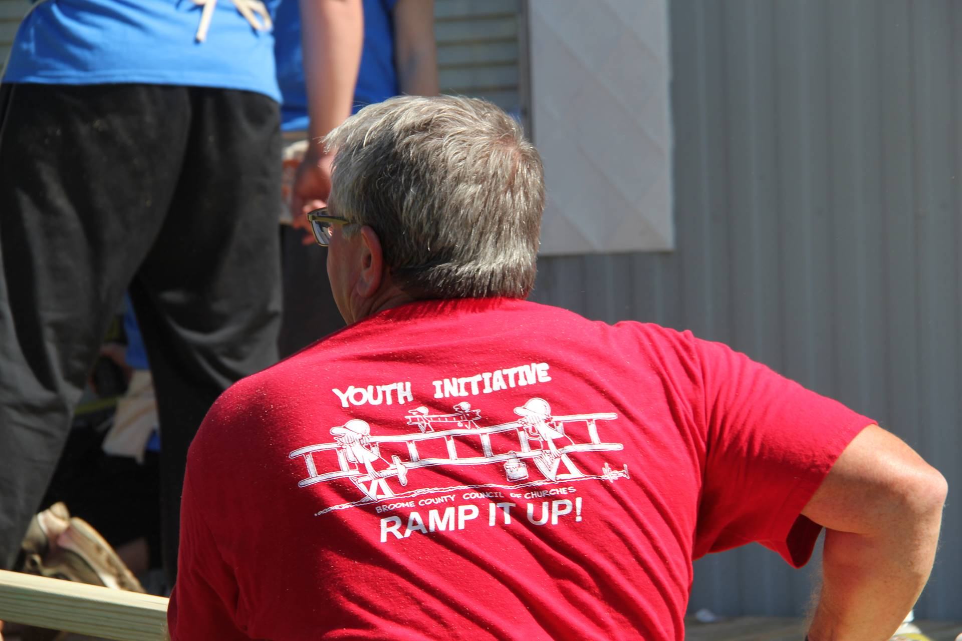 back of red shirt that says ramp it up initiative