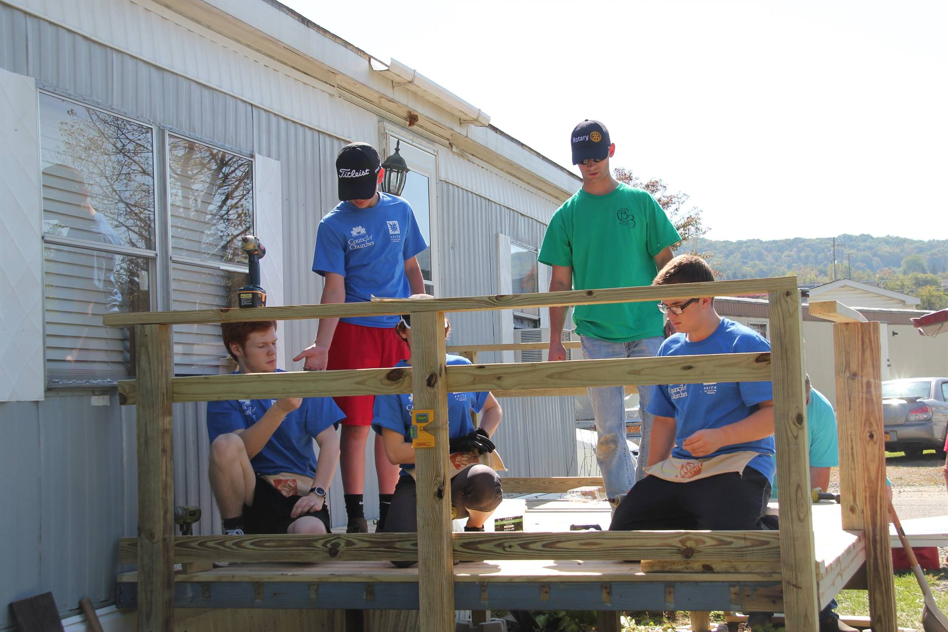group working together on building deck