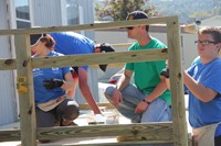 students and member of hillcrest rotary building deck