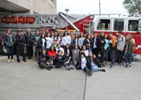 group posing in front of fire truck at binghamton fire department
