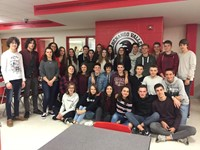french exchange students smile for a picture in high school cafeteria