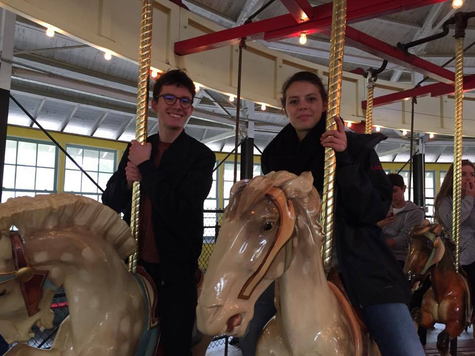 two students riding carousel