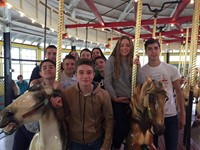 group of students riding carousel