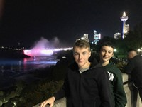 students by niagra falls at night