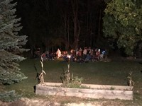 students at campfire outside