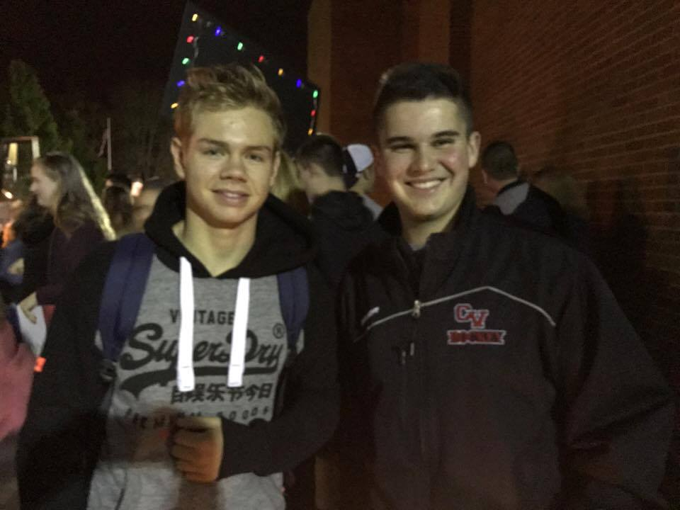 two male students on night welcoming french exchange students