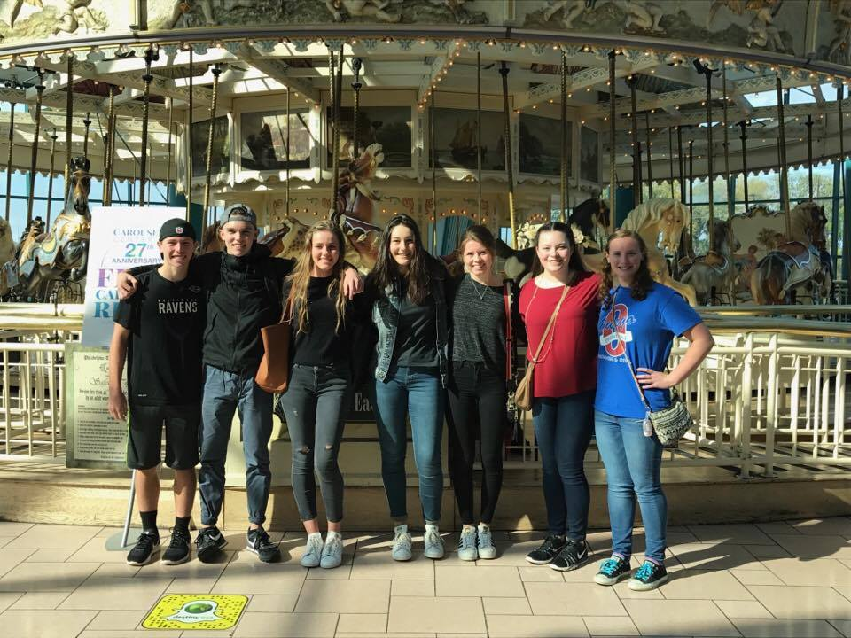 group of students in front of carousel at destiny u s a mall