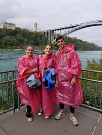students at niagra falls wearing ponchos