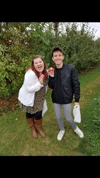 two students apple picking