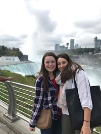 two female students in front of niagra falls
