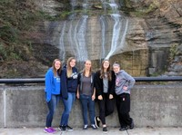 students pose in front of falls