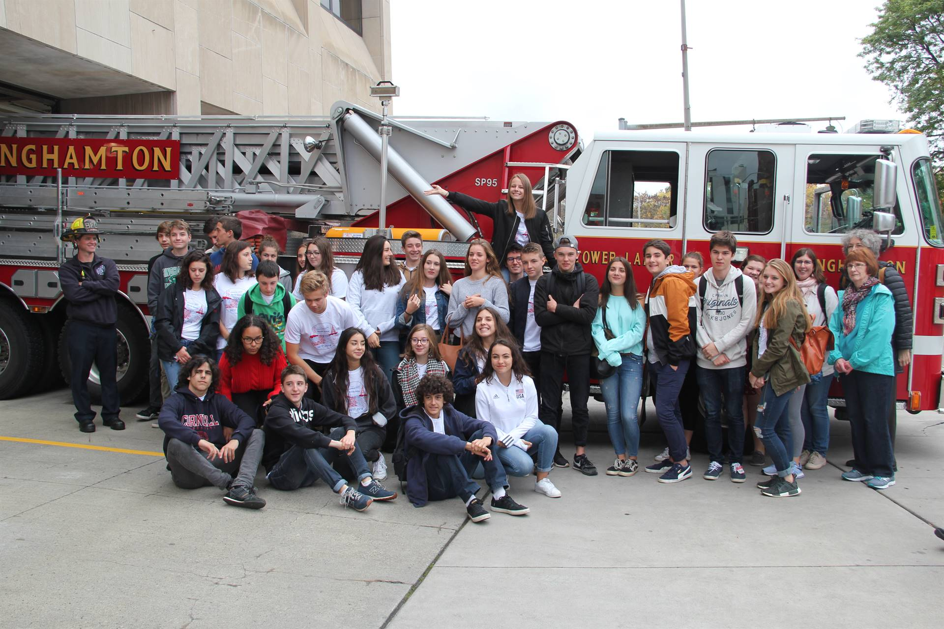 students and teachers in front of fire truck