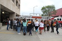 wide shot of student outside of binghamton fire department