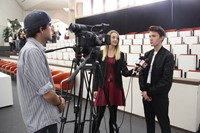 student being interviewed by local media