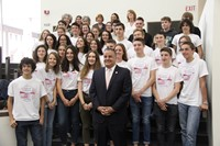 students smile in picture with binghamton mayor rich david