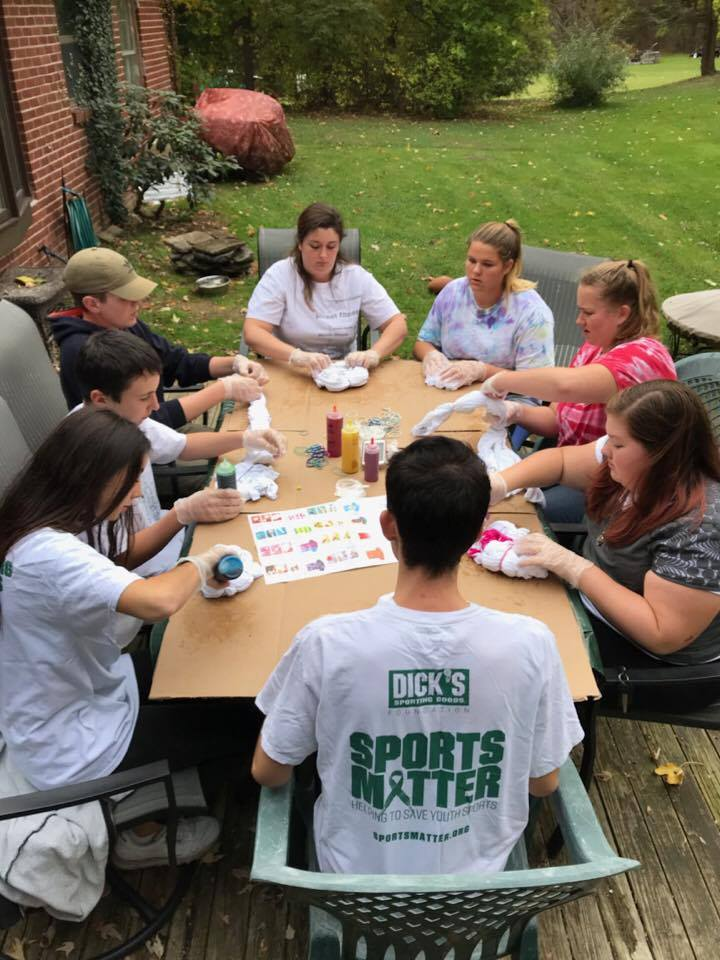 group of students tie dying shirts