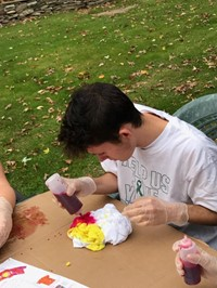 male student tie dying shirt