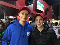 two male students at binghamton devils hockey game