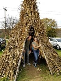students in corn hut