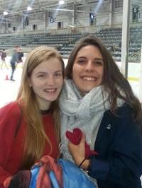 students smile at hockey rink