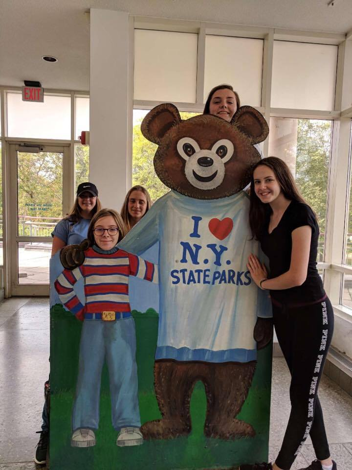 students pose with bear cut out