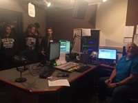 students talk to man who does radio