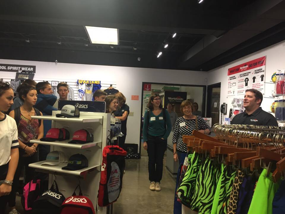 students inside of gift shop talking to owner