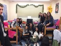 students pose inside of dorm room
