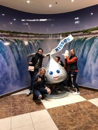students pose with giant hershey kiss