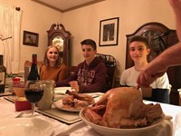 students about to eat a turkey dinner