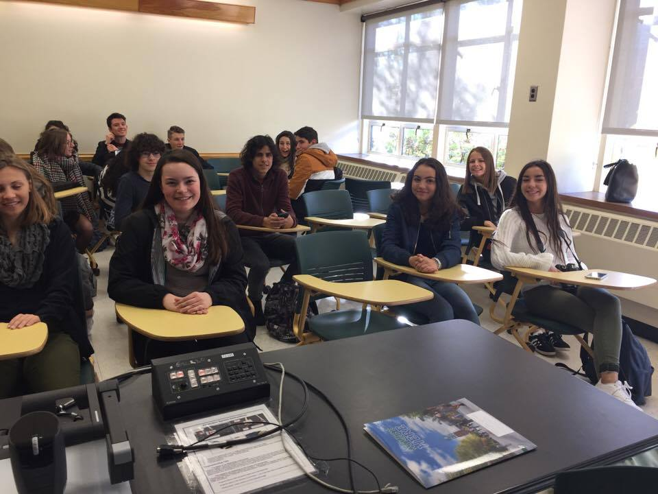 students smile sitting in classroom