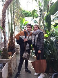 two students in green house