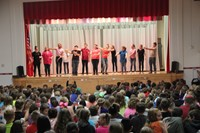 all of the middle school students stand together at the end of the play