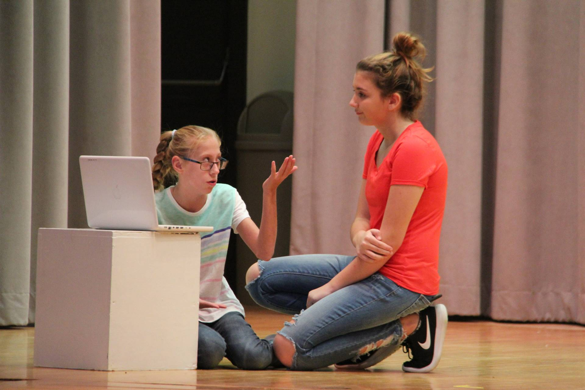 female students in scene involving a laptop and emails