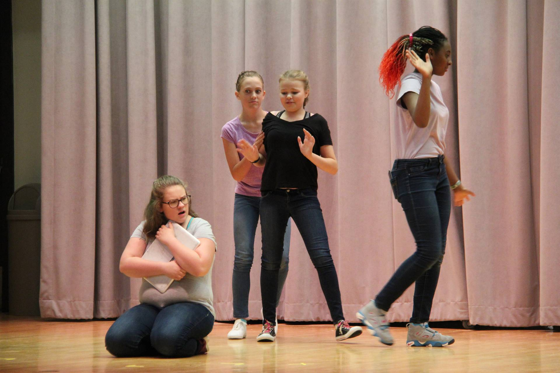 female students acting in play