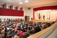 wide shot of students acting in play