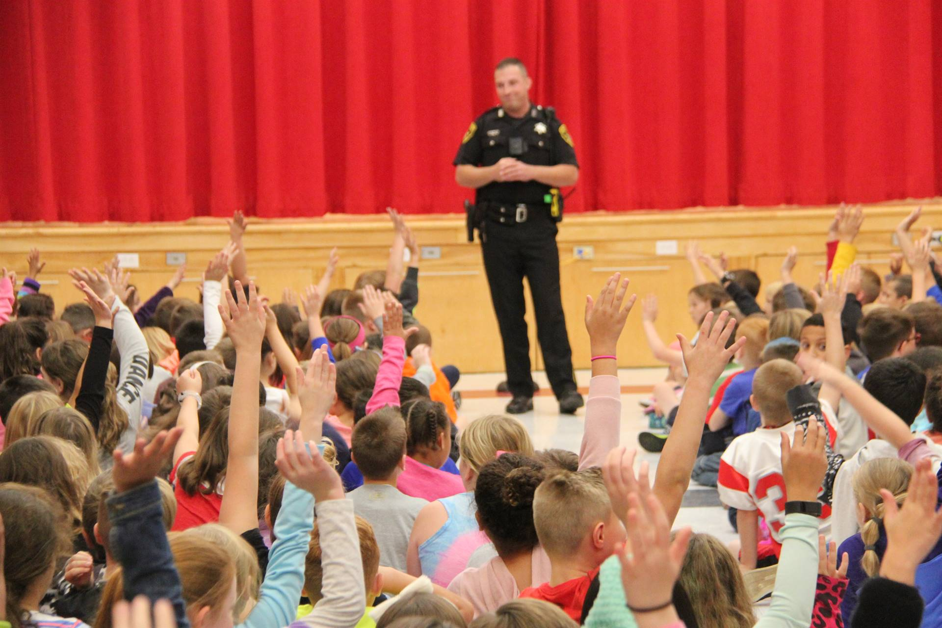 students raise their hands to answer deputy stapletons question