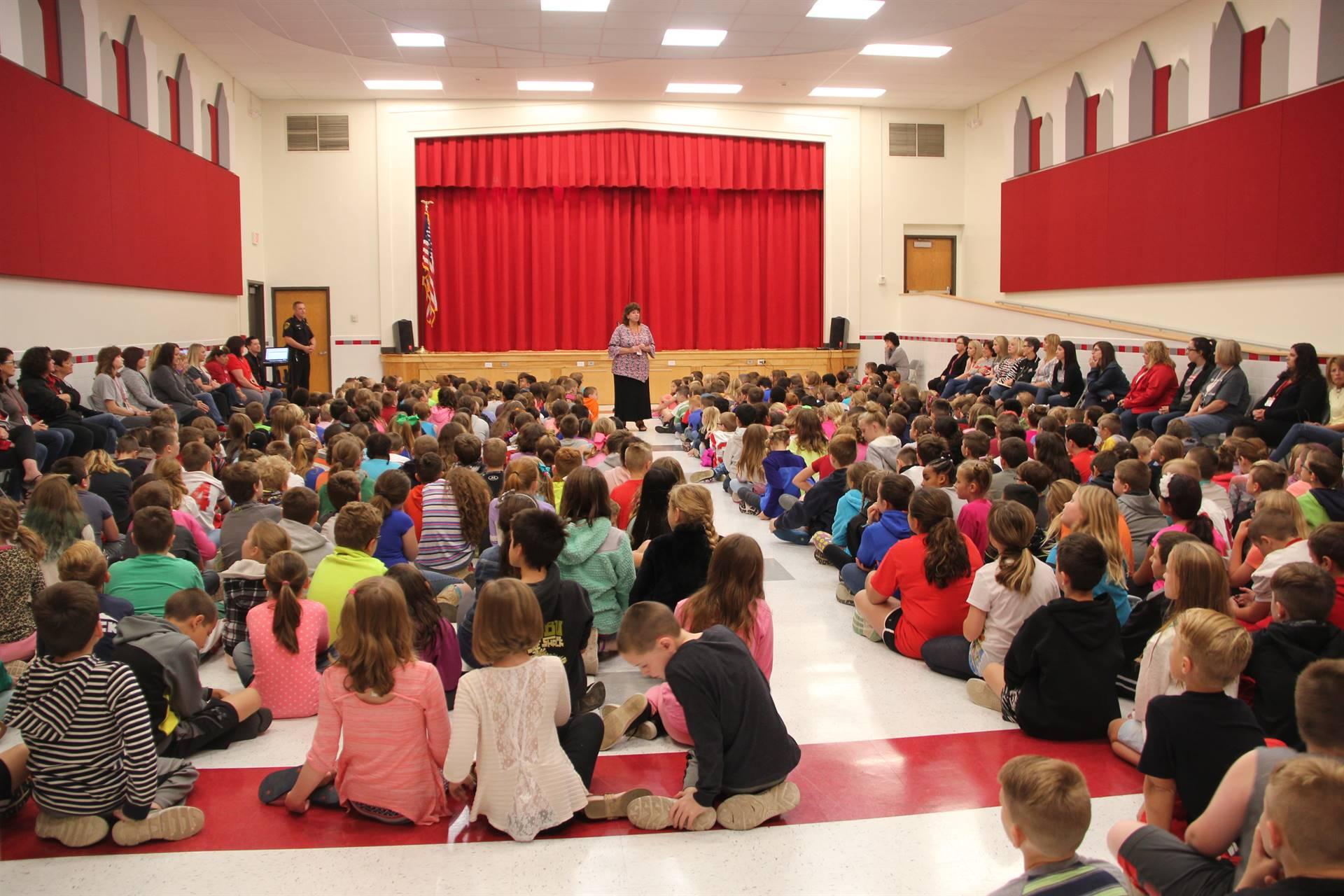 principal hammond talks to students