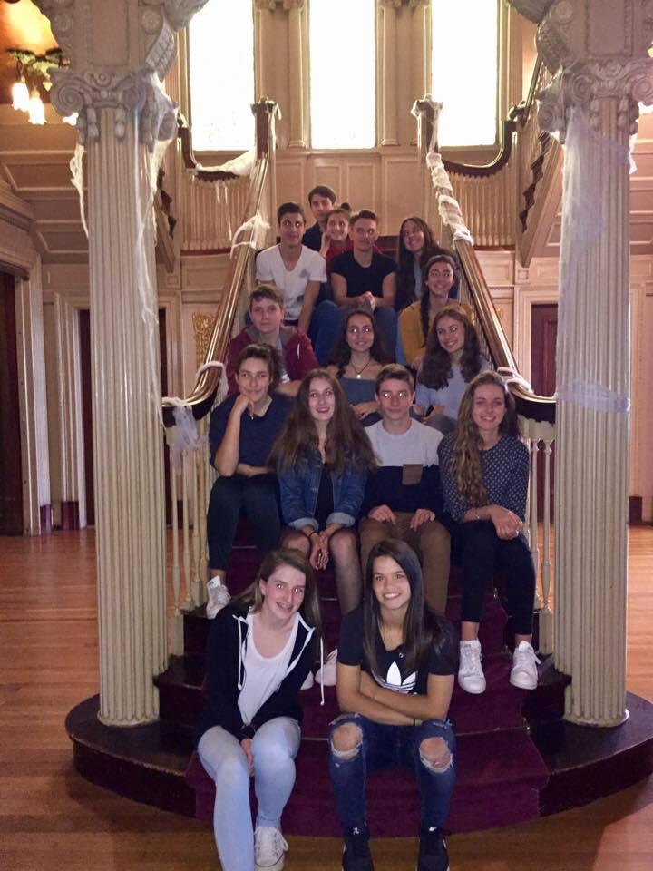 students sitting on stairs at roberson mansion
