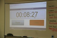 online stop watch displayed on white board