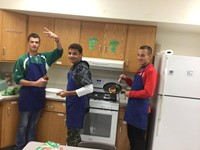 students making grilled cheese in f a c s kitchen