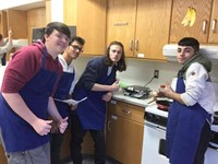 students with their grilled cheese sanwich in gourmet foods class