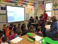 students reading to elementary students