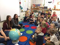 students smile with class of port dickinson elementary students