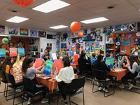 large group of students take part in painting class