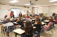 french exchange students talk to classroom of students