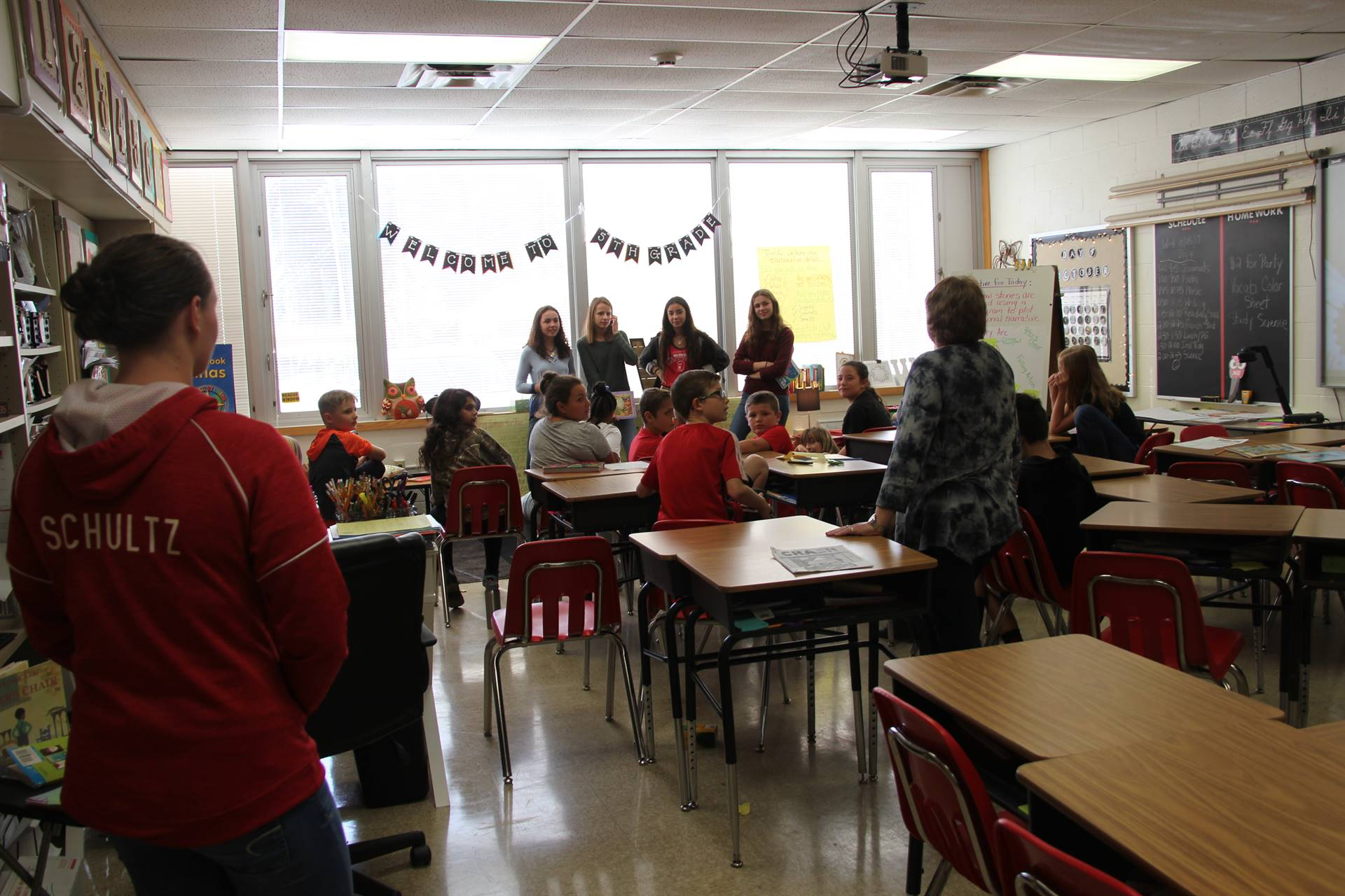 french students talking in elementary classroom