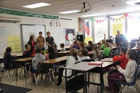 french students answer questions in elementary classroom